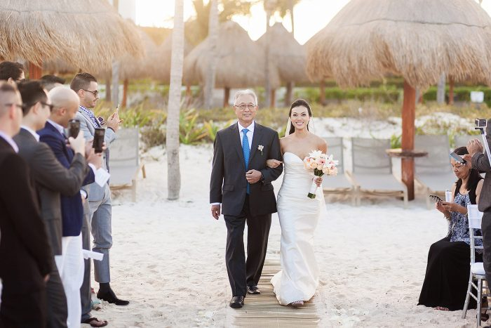 Bride walking down aisle to beach wedding in Cancun | Dean Sanderson Weddings