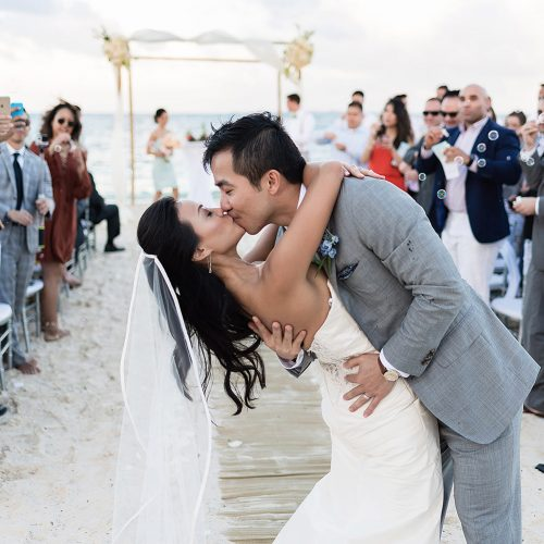 Bride and groom kissing after ceremony in Cancun