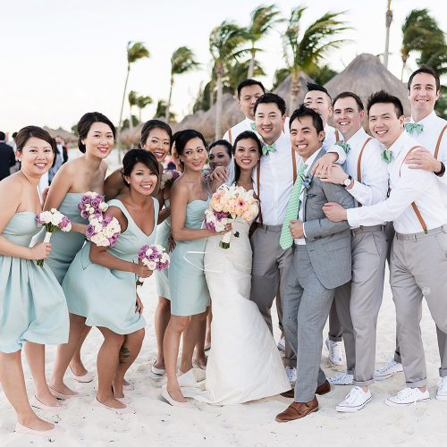 Fun portrait of bridal party shortly after wedding ceremony in Cancun