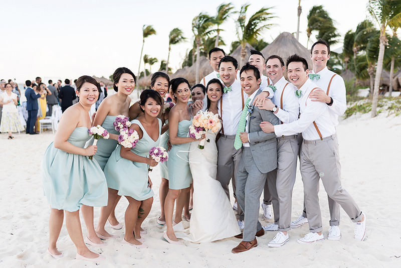 Bridal party having fun after wedding ceremony on beach.