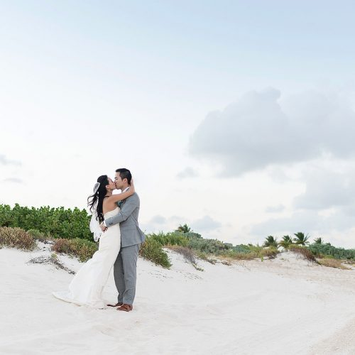 Bride and groom portrait on beach in Cancun