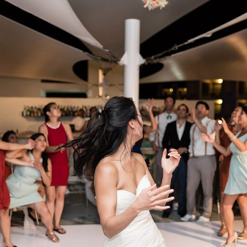 Bride tossing bouquet at Finest Playa Mujeres Resort