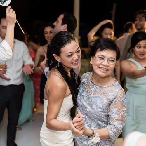 Bride dancing with mother at wedding reception