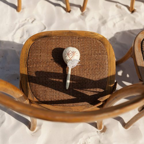 Maraca on chair at wedding ceremony at el Paraiso Tulum