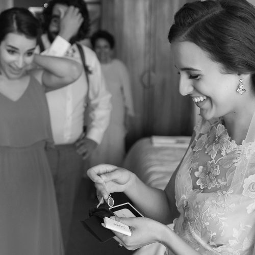 Bride opening gift before wedding at el Paraiso Tulum