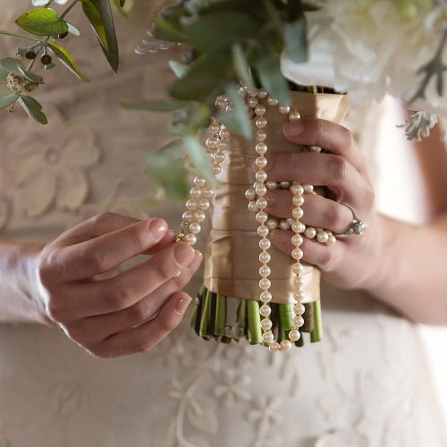 Close up of bouquet and pearls at wedding in Tulum