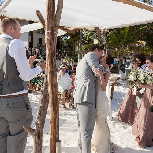 Bride and grooms first kiss at Tulum wedding