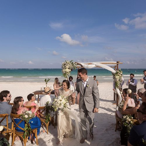 Bride and groom walking down aisle after wedding at el Paraiso Tulum