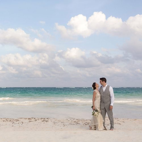 Bride and groom on beach in Tulum.