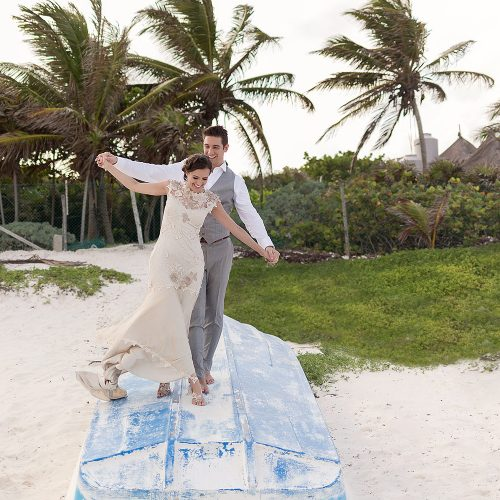 Bride and groom having fun on boat in Tulum