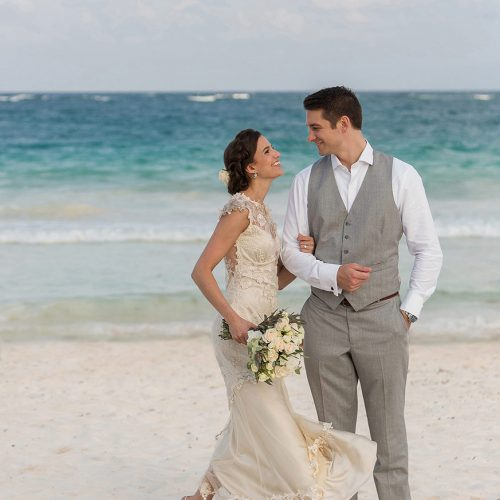 Bride and groom portrait on beach in Tulum