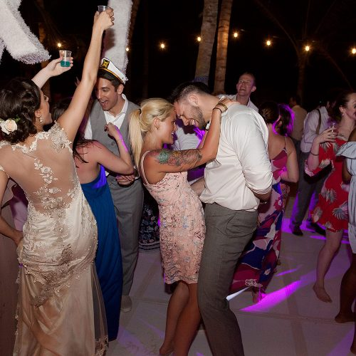 Guests dancing at wedding reception in Tulum