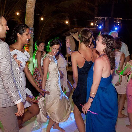 Bride dancing at wedding in Tulum