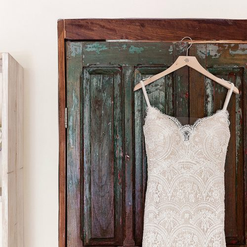Dress and flowers hanging before wedding in Tulum