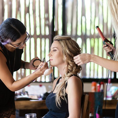 Bride having makeup put on for Tulum wedding
