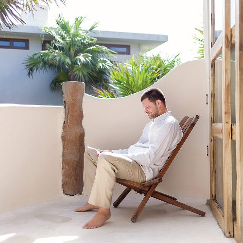 Groom reading before wedding in Tulum