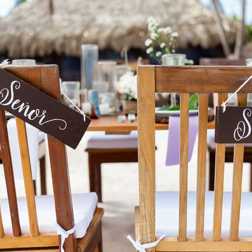 Bride and grooms chairs at wedding reception