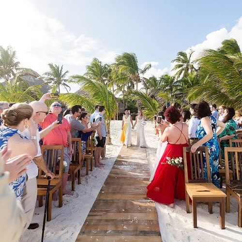 Bride walking down aisle at Akiin wedding in Tulum