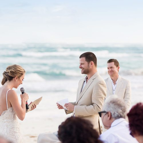 Bride and groom giving vows at beach wedding in Tulum