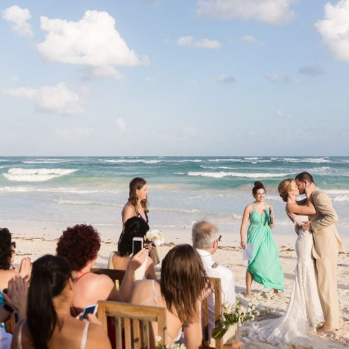 Bride and groom at beach wedding in Tulum