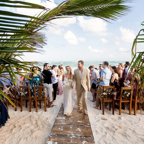 Bride and groom after beach wedding ceremony at Akiin, Tulum