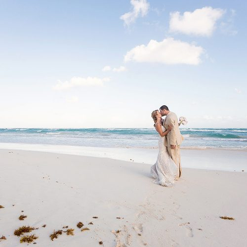 Romantic kiss, bride and groom after wedding in Tulum
