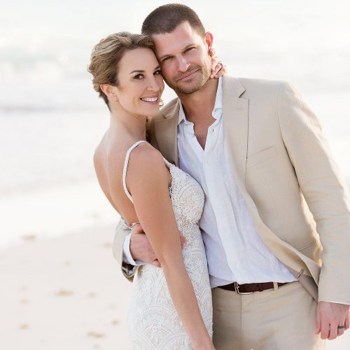 Portrait of bride and groom on beach in Tulum