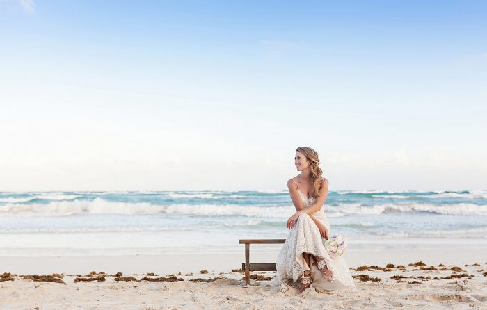 Portrait of bride on bench in Tulum