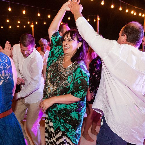 Guests dancing at Akiin Tulum wedding
