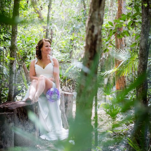 Bride and bouquet at Trash the dress in Mayan Cenote at Riviera Maya