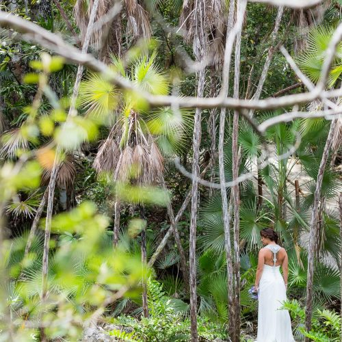 Bride standing at the entrance of Mayan Cenote at Riviera Maya