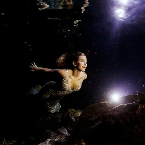 Bride underwater in Mayan cenote Trash the dress