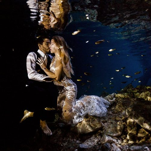 Couple about to kiss in underwater photo shoot in Maya Cenote