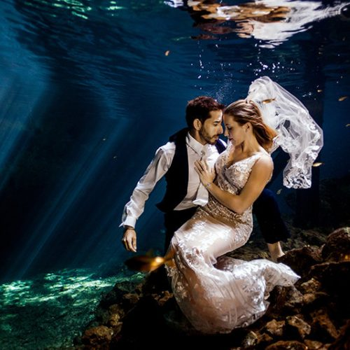 Couple portrait in underwater photo shoot in Maya Cenote
