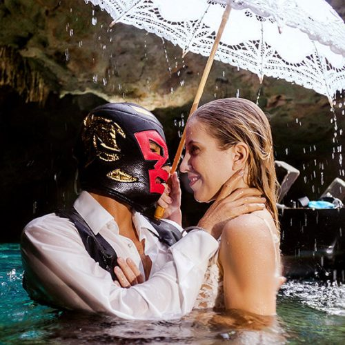 Groom wearing a mask in photoshoot on a Maya cenote