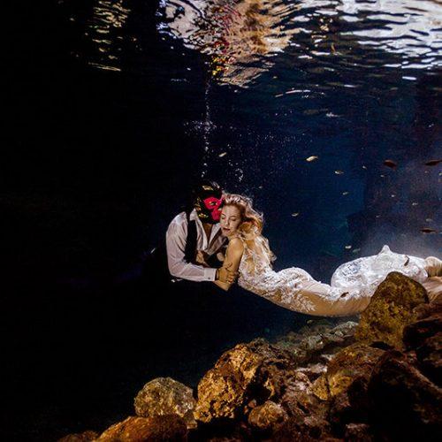 Bride and groom in fun underwater photo shoot at Maya Cenote