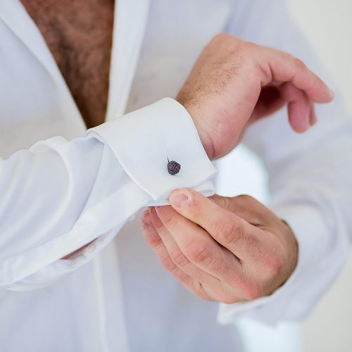 Close up of grooms cuff links.