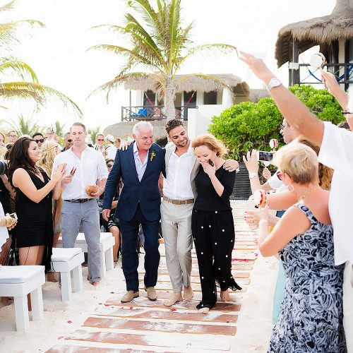 Groom walking down the aisle at Riviera Maya wedding