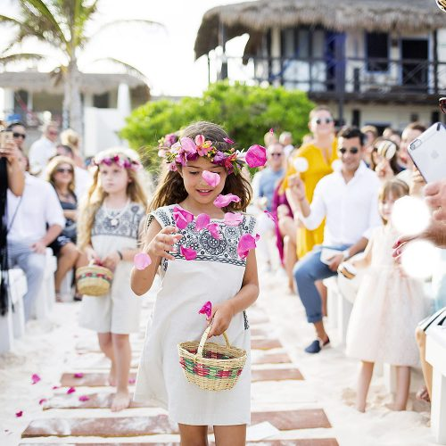 Flower girl throwing flowers at Riviera Maya wedding