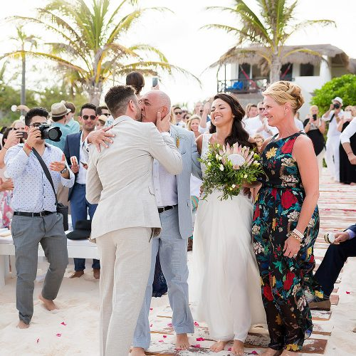Bride and groom meeting at wedding ceremony on beach