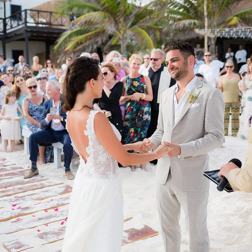 bride and groom on at wedding ceremony on beach in the Riviera Maya