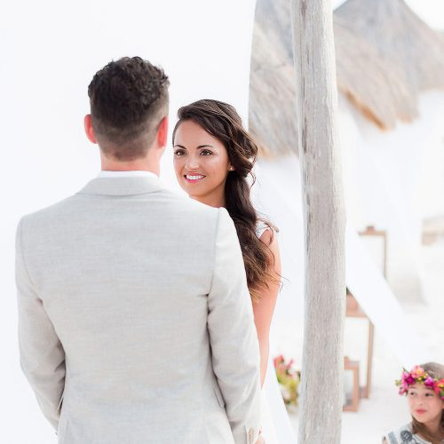 Bride and groom giving vows at beach wedding