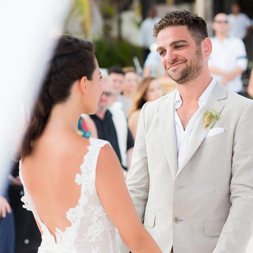 Groom looking at bride during vows