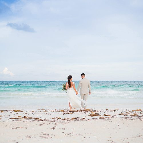 Bride and groom on beach after wedding ceremony