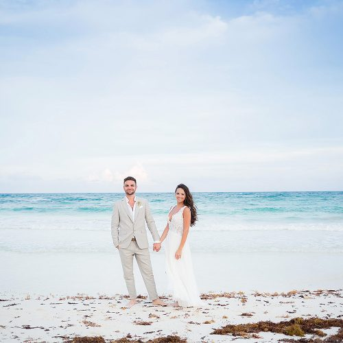 Portrait of bride and groom on beach