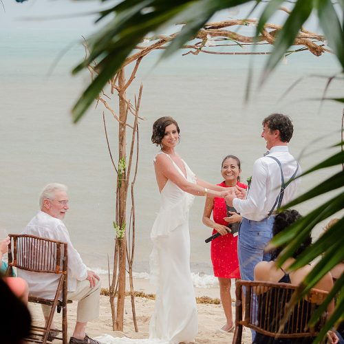 Bride and groom during ceremony in Tulum