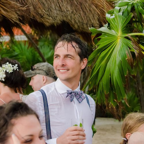 Groom soaking wet after wedding ceremony in Tulum