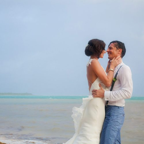 Bride and groom being romantic after wedding in Tulum