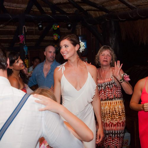 Bride dancing at her wedding reception in Tulum