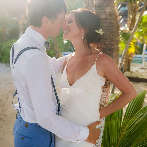 Romantic photograph of bride and groom in garden in Tulum